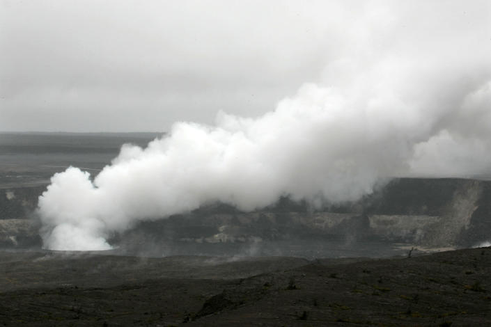 FILE - In this file photo from Sunday, March 8, 2009, steam and gas emits from the year-old fumarole in the Halemaumau Crater of Kilauea's summit caldera in Hawaii Volcanoes National Park. Part of what makes living in Hawaii so pleasant is the gentle breezes. Nowadays, these breezes, called trade winds, are declining, a drop that's slowly changing life across the islands. (AP Photo/Chris Stewart)
