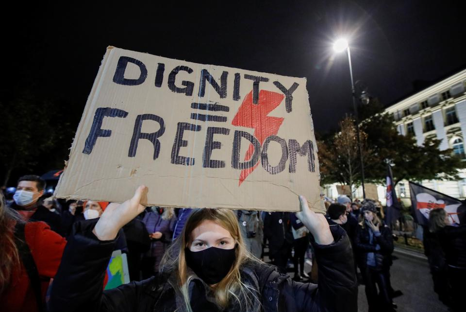<p>A woman takes part in a protest against the ruling by Poland's constitutional tribunal that imposes a near-total ban on abortion in Warsaw on 30 October</p>Reuters