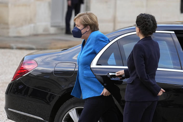 German Chancellor Angela Merkel arrives for a meeting with France's President Emmanuel Macron, at the Elysee Palace, in Paris, Thursday, Sept. 16, 2021. (AP Photo/Michel Euler)