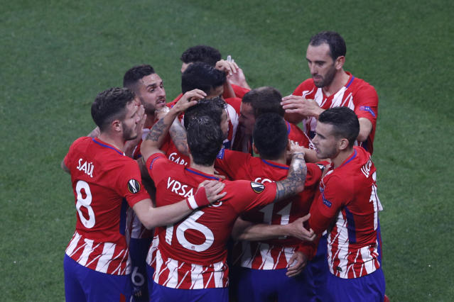 Atletico players celebrate teammate Antoine Griezmann's opening goal during the Europa League Final soccer match between Marseille and Atletico Madrid at the Stade de Lyon outside Lyon, France, Wednesday, May 16, 2018. (AP Photo/Christophe Ena)