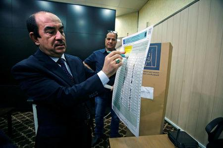 The head of Iraq's Independent Higher Election Commission Dr. Riyhad Al-Badran speaks during an interview with Reuters in Baghdad