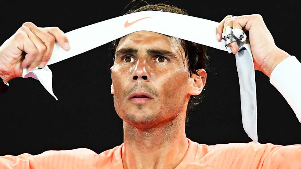 Rafa Nadal (pictured) putting on his headband during the Australian Open.
