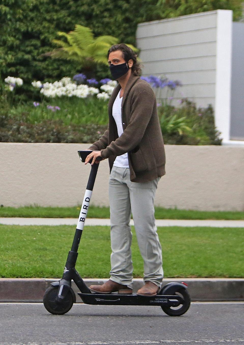<p>Brad Falchuk finds a new way to get some fresh air — a Bird electric scooter! — in L.A. on Wednesday.</p>