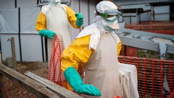 In this photograph taken Saturday July 13, 2019, health workers wearing protective suits take their shift at a treatment center in Beni, Congo DRC. The head of the World Health Organization is convening a meeting of experts Wednesday July 17, 2019 to (The Associated Press)