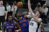 Detroit Pistons forward Saddiq Bey (41) is fouled by San Antonio Spurs center Jakob Poeltl (25) during the second half of an NBA basketball game in San Antonio, Thursday, April 22, 2021. (AP Photo/Eric Gay)