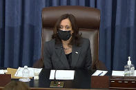 In this image from Senate TV, Vice President Kamala Harris sits in the chair on the Senate floor to cast the tie-breaking vote, her first, Friday, Feb. 5, 2021 at the Capitol in Washington. The Senate early Friday approved a budget resolution that paves the way for fast-track passage of President Joe Biden's $1.9 trillion coronavirus relief plan without support from Republicans. (Senate TV via AP)