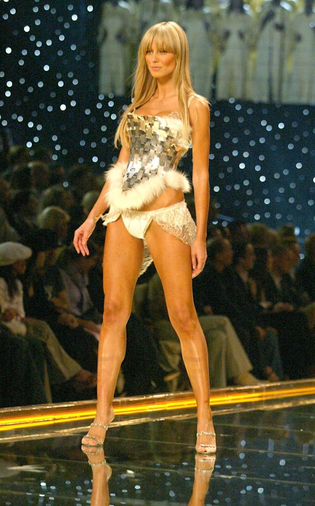 Heidi Klum, working the runway at the 2002 Victoria's Secret Fashion Show, says she missed out on a lot of runway work because she was curvier than her peers. (Photo: Getty Images)
