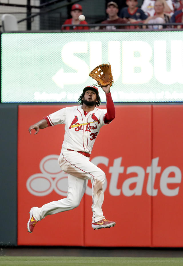 St. Louis Cardinals right fielder Jose Martinez leaps to catch a fly ball by Arizona Diamondbacks' Jake Lamb for an out during the sixth inning of a baseball game Saturday, July 13, 2019, in St. Louis. (AP Photo/Jeff Roberson)