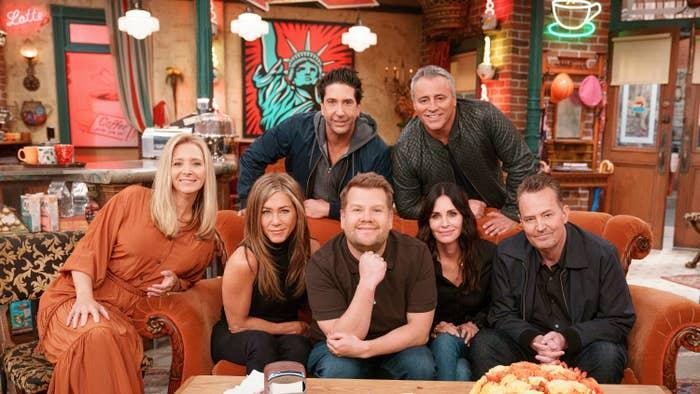 The cast of Friends with James Corden on the couch