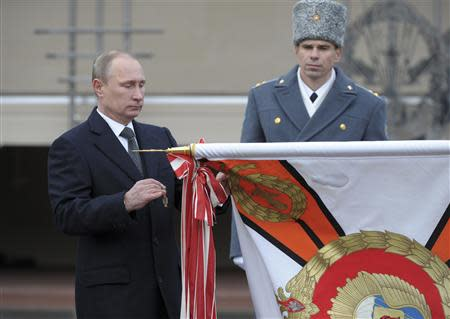 Russia's President Vladimir Putin takes part in a ceremony to award the Margelov Ryazan Higher Airborne Command School with the Order of Suvorov in Ryazan region
