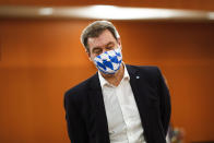 File - In this Wednesday, June 17, 2020 file photo Bavarian Prime Minister Markus Soeder of the Christian Social Union, CSU, party, wears a face mask with Bavarian's white and blue diamond pattern as he arrives for a meeting with German Chancellor Angela Merkel and German federal states governors at the chancellery in Berlin, Germany. German Chancellor Angela Merkel's center-right party, the Christian Democratic Union, CDU, is choosing a new leader on the weekend Saturday Jan. 16 and Sunday Jan. 17, 2021, a decision that will help determine who succeeds Merkel at the helm of the European Union's biggest economy after a 16-year reign. (AP Photo/Markus Schreiber, Pool, file)