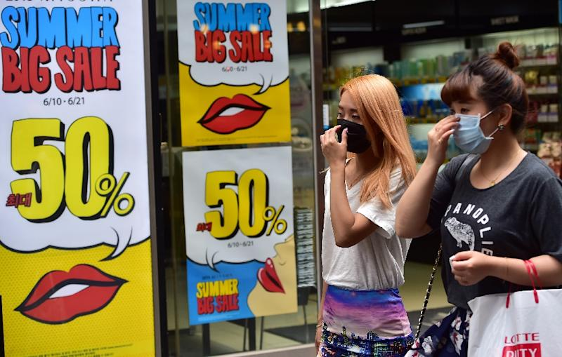 Businesses in South Korea have reported a sharp drop in sales as people shun public venues with large crowds as panic spreads over the MERS virus (AFP Photo/Jung Yeon-Je)