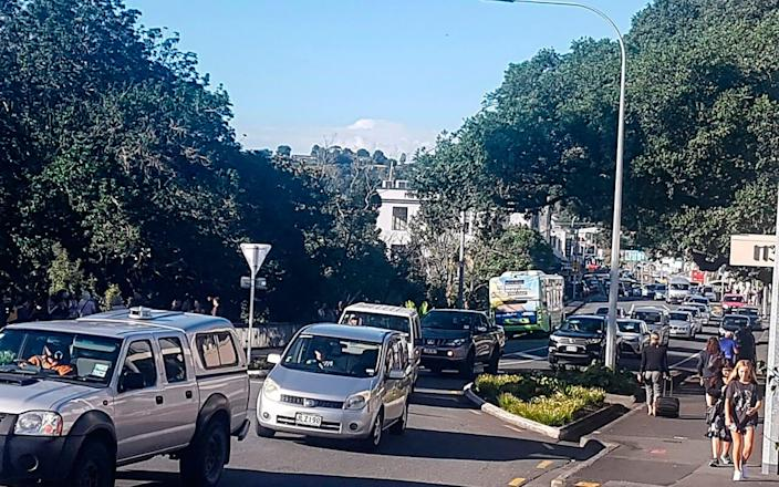 Traffic slowly works up to high ground at Whangarei, New Zealand, after a tsunami warning is issued