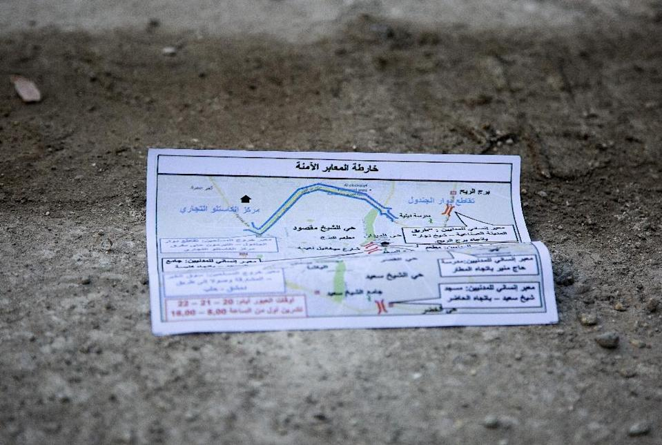 A flyer bearing a map reportedly distributed by the government encouraging people to leave a rebel-held area of the northern embattled city of Aleppo is seen lying in the street (AFP Photo/Karam al-Masri)