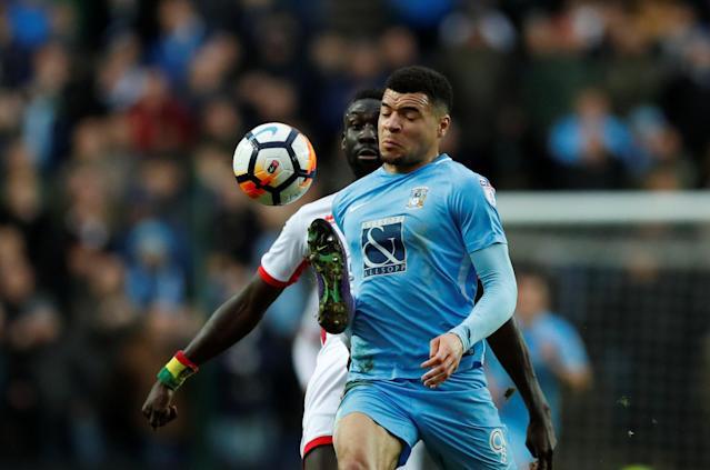 Soccer Football - FA Cup Fourth Round - Milton Keynes Dons vs Coventry City - Stadium MK, Milton Keynes, Britain - January 27, 2018 MK Dons' Ousseynou Cisse in action with Coventry's Maxime Biamou Action Images/Andrew Boyers