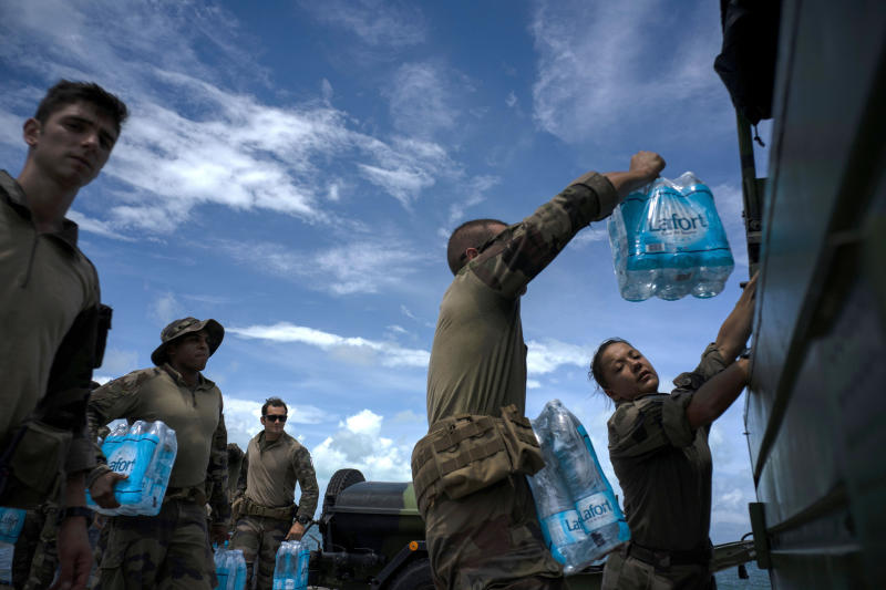 French soldiers load water to assist in the reconstruction in the aftermath of Hurricane Dorian in Abaco, Bahamas, Monday, Sept. 16, 2019. Dorian hit the northern Bahamas on Sept. 1, with sustained winds of 185 mph (295 kph), unleashing flooding that reached up to 25 feet (8 meters) in some areas. (AP Photo/Ramon Espinosa)