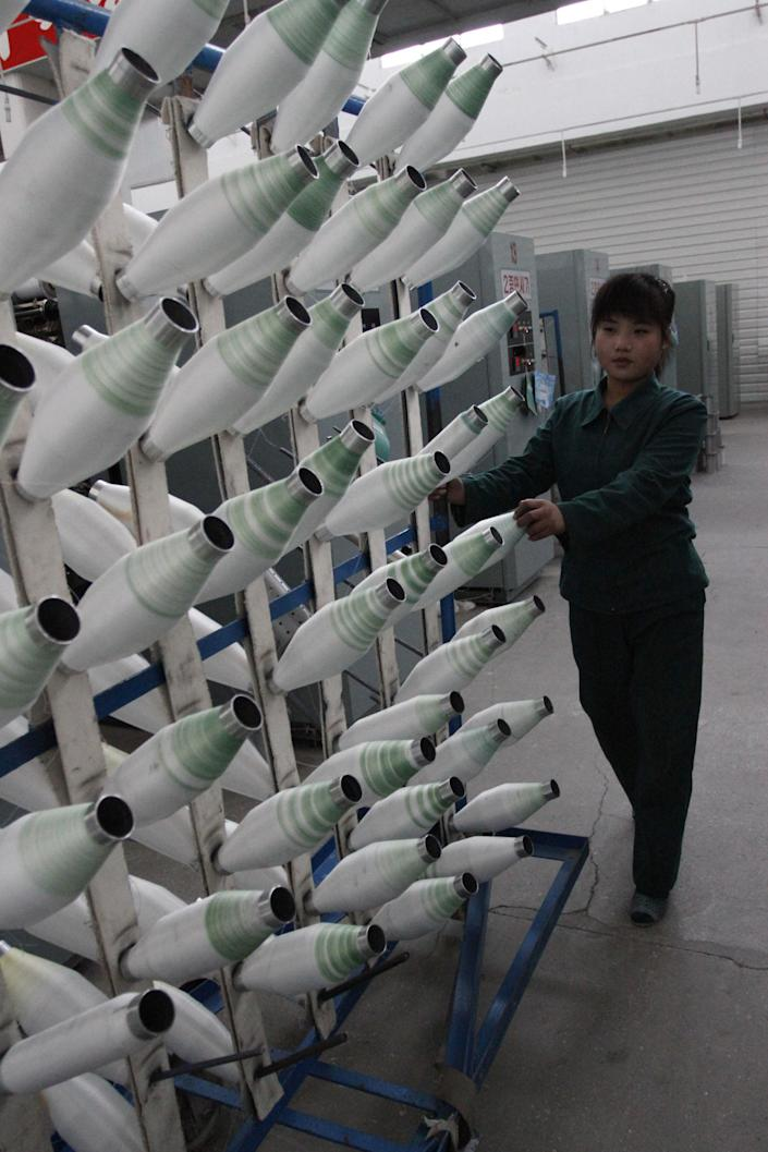 In this Jan. 30, 2012 photo, North Korean women work at a machines inside a factory that produces stockings in Pyongyang, North Korea. (AP Photo/Kim Kwang Hyon)