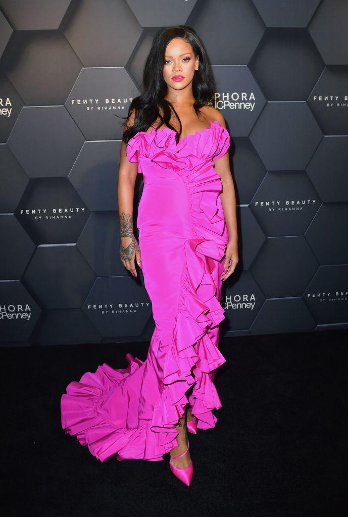 <p>Rihanna is never one to shun the spotlight so unsurprisingly opted for a fuschia-hued dress for the anniversary party of her beauty label on September 14. <em>[Photo: Getty]</em> </p>