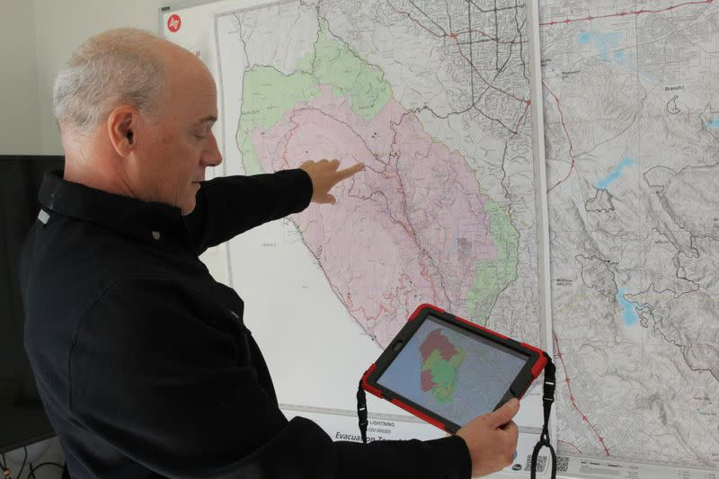 Zonehaven CEO and founder Charlie Crocker shows the how the platform assists with evacuation management using a map of the recent CZU fire at his home in San Francisco