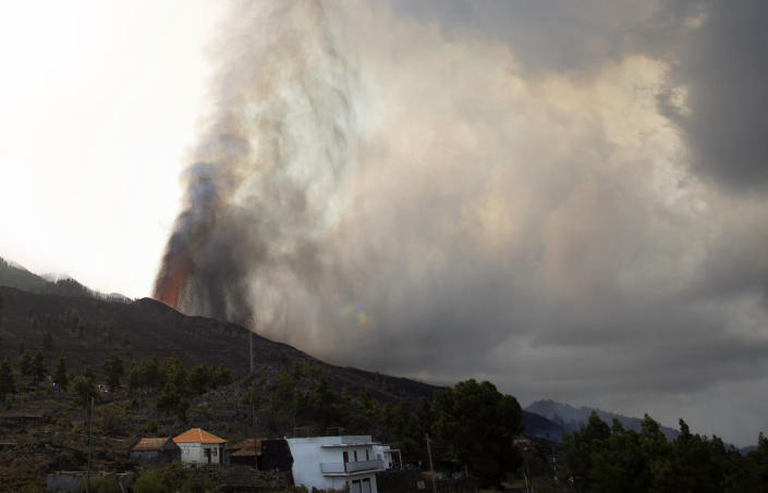 Lava flows from an eruption of a volcano near El Paso on the island of La Palma in the Canaries, Spain, of Monday, Sept. 20, 2021. Lava continues to flow slowly from a volcano that erupted in Spain's Canary Islands off northwest Africa. The head of the islands' regional government says Monday he expects no injuries to people in the area after some 5,000 were evacuated. (AP Photo/Gerardo Ojeda)