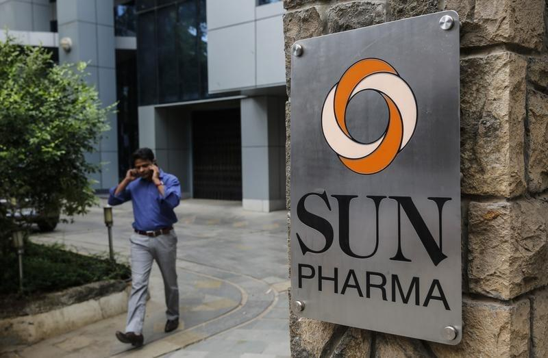 An employee speaks on phone as he walks out of research and development centre of Sun Pharmaceutical Industries Ltd in Mumbai
