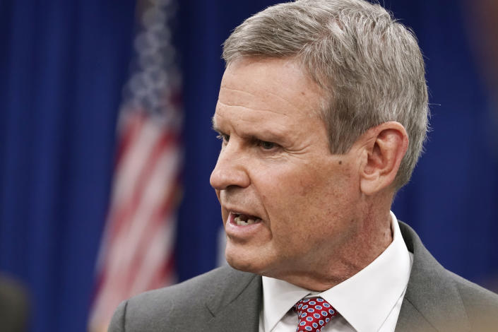 FILE - In this Nov. 10, 2020, file photo, Tennessee Gov. Bill Lee talks with reporters in Nashville, Tenn. Gov. Lee has backed the idea of allowing most adults 21 and older to carry firearms, concealed or openly, without first having to get a license that currently requires a background check and training. Several states are eyeing similar proposals this year. (AP Photo/Mark Humphrey, File)