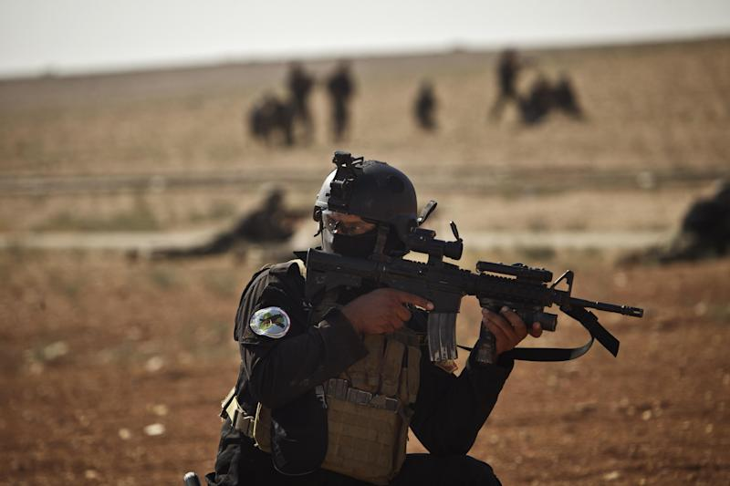 An Iraqi Counter Terrorist forces soldier participates in a rehearsal with forces from Jordan and Lebanon as part of Eager Lion, a multinational military exercise in Zarqa, Jordan, Monday, June 17, 2013. (AP Photo/Maya Alleruzzo)