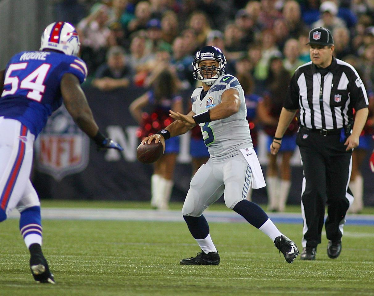 TORONTO, ON - DECEMBER 16:  Russell Wilson #3 of the Seattle Seahawks looks to throw against the Buffalo Bills at Rogers Centre on December 16, 2012 in Toronto, Ontario.  (Photo by Rick Stewart/Getty Images)