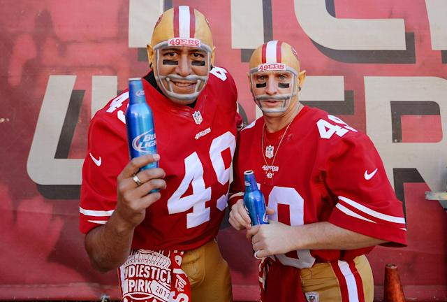 "SAN FRANCISCO, CA - DECEMBER 08: San Francisco 49ers fans ""The Helmet Heads"" Paul Maldonado (L) and Marcus Sperry (R) from Sacramento, Ca enjoys a beer prior to the start of an NFL football game between the Seattle Seahawks and 49ers at Candlestick Park on December 8, 2013 in San Francisco, California. (Photo by Thearon W. Henderson/Getty Images)"