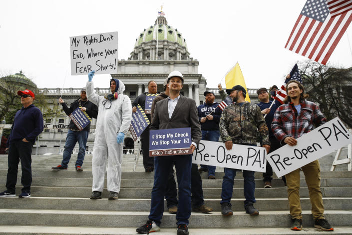 Protesters demonstrate at the state Capitol in Harrisburg, Pennsylvania, demanding that Gov. Tom Wolf reopen Pennsylvania's economy.