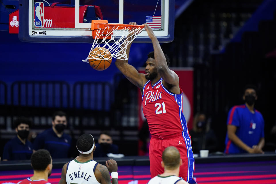 Philadelphia 76ers' Joel Embiid dunk s the ball during the second half of an NBA basketball game against the Utah Jazz, Wednesday, March 3, 2021, in Philadelphia. (AP Photo/Matt Slocum)