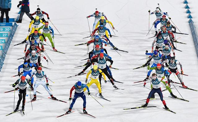 FILE PHOTO: Biathlon - Pyeongchang 2018 Winter Olympics - Men's 15 km Mass Start Final - Alpensia Biathlon Centre - Pyeongchang, South Korea - February 18, 2018 - Athletes compete at the start of the race. REUTERS/Toby Melville/File Photo