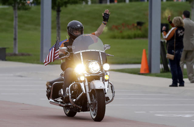 FILE – In this Aug. 2, 2013 file photo, Wisconsin Governor Scott Walker rides a Harley Davidson motorcycle to the motorcycle museum in Milwaukee. (AP Photo/Jeffrey Phelps, File)