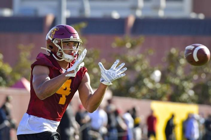 "A mysterious illness left USC receiver Bru McCoy is a bad frame of mind. It took a one-on-one meeting with coach Clay Helton to help McCoy turn a corner. <span class=""copyright"">(John McGillen / USC Athletics)</span>"