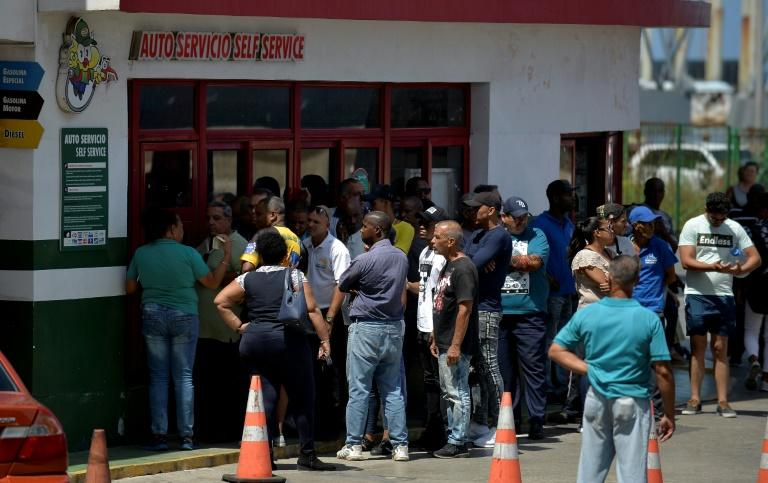 Long lines of people waiting endless hours outside service stations have flooded Cubans' social media feeds (AFP Photo/YAMIL LAGE)