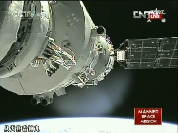 This still from a CNTV bradcast shows the view from a camera aboard China's Shenzhou 9 space capsule shows the spacecraft just after it was manually docked to the Tiangong 1 space lab by astronaut Liu Wang on June 24, 2012.