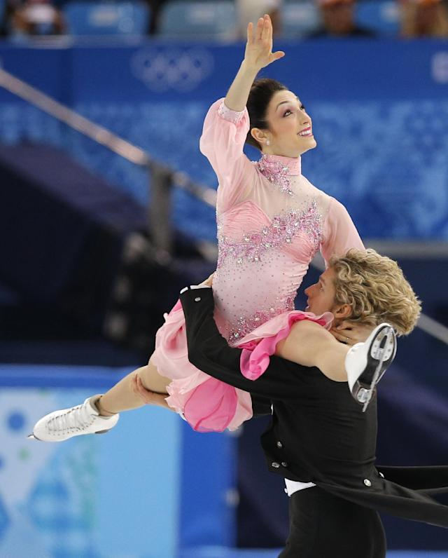 Meryl Davis and Charlie White of the United States compete in the ice dance short dance figure skating competition at the Iceberg Skating Palace during the 2014 Winter Olympics, Sunday, Feb. 16, 2014, in Sochi, Russia