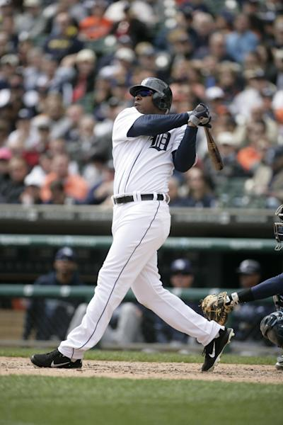 FILE - In this April 12, 2012, file photo, Detroit Tigers' Delmon Young bats against the Tampa Bay Rays during a baseball game in Detroit. Young has been arrested on a hate crime assault charge after police say he attacked a group of men and yelled anti-Semitic epithets in New York. He was first hospitalized because he was believed to be intoxicated, police said, but he was believed to be at a police precinct. A call to the team and a message sent to his agent weren't immediately returned Friday, April 27. (AP Photo/Duane Burleson, File)