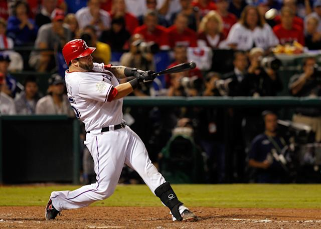 ARLINGTON, TX - OCTOBER 23: Mike Napoli #25 of the Texas Rangers hits a three-run home run in the sixth inning during Game Four of the MLB World Series against the St. Louis Cardinals at Rangers Ballpark in Arlington on October 23, 2011 in Arlington, Texas. (Photo by Tom Pennington/Getty Images)