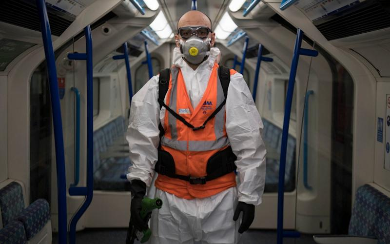 TfL worker Noureddine Aouf, who is responsible for spraying anti viral solution Zoono-71 inside Victoria Line tube trains, at the London Underground Northumberland Park Depot in Tottenham - PA