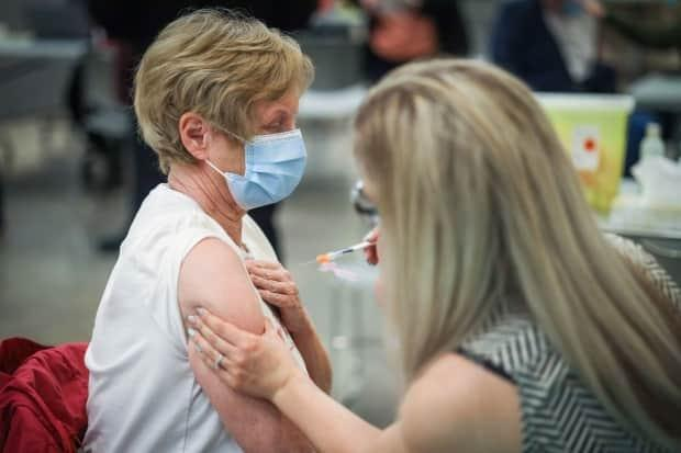 Gail Sparling, 74, receives a COVID-19 vaccine in Okotoks on May 26.  (AHS - image credit)