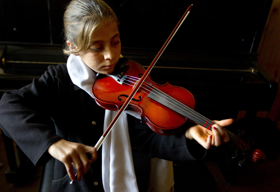 Marjan Fidaye,11, practices during violin lessons at the Afghanistan National Institute of Music on September 26, 2010 in Kabul, Afghanistan. (Paula Bronstein /Getty Images)