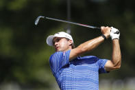 Kevin Kisner hits from the 15th tee during the second round of the Rocket Mortgage Classic golf tournament, Friday, July 3, 2020, at the Detroit Golf Club in Detroit. (AP Photo/Carlos Osorio)