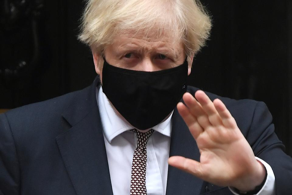 LONDON, ENGLAND - JANUARY 13: Prime Minister, Boris Johnson leaves number 10 Downing Street  for PMQs at the House of Commons on January 13, 2021 in London, England.  (Photo by Chris J Ratcliffe/Getty Images)