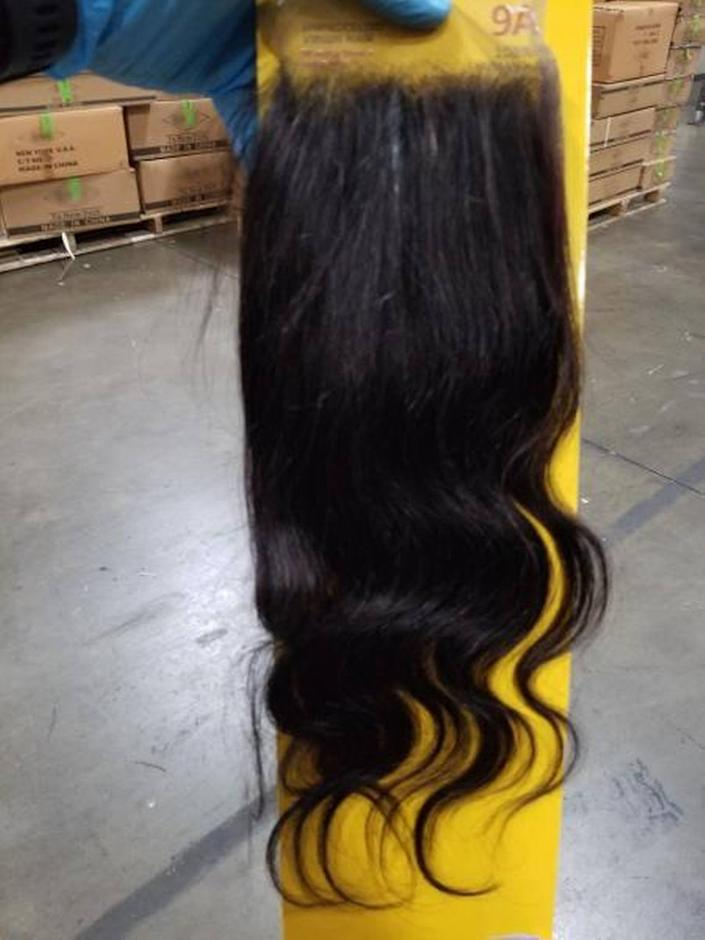 U.S. Customs and Border Protection detains Chinese shipment of suspected forced labor products made with human hair.