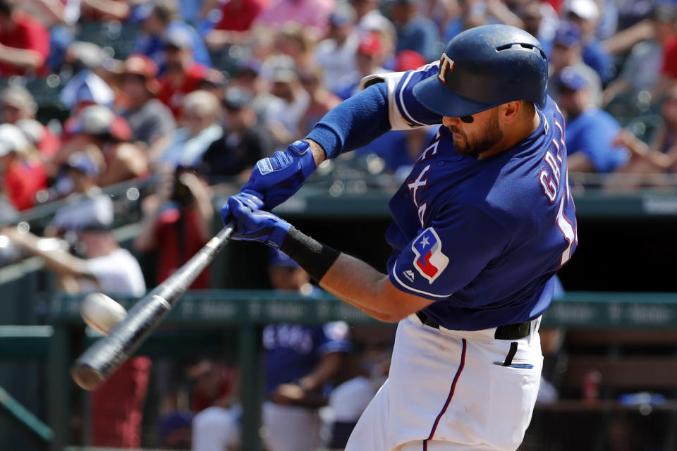 FILE - In this June 1, 2019, file photo, Texas Rangers' Joey Gallo connects for a two-run home run on a pitch from Kansas City Royals' Homer Bailey in the fourth inning of a baseball game in Arlington, Texas. Rangers slugger Joey Gallo has tested positive for COVID-19, though the team says the All-Star right fielder is asymptomatic. General manager Jon Daniels said Monday, July 6, 2020, that Gallo is isolated at his apartment in Dallas and not around teammates. (AP Photo/Tony Gutierrez, File)