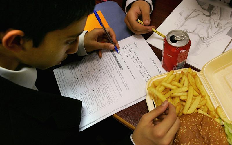 In areas such as Camberwell Green children have dozens of fast food options on their way home - Getty Images