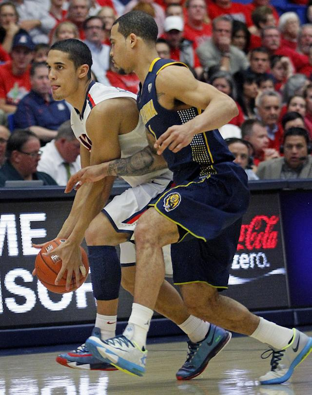 Arizona's Nick Johnson, left, struggles with California's Justin Cobbs, right, at midcourt in the second half of an NCAA college basketball game on Wednesday, Feb. 26, 2014, in Tucson, Ariz. Arizona won 87 - 59. (AP Photo/John MIller)