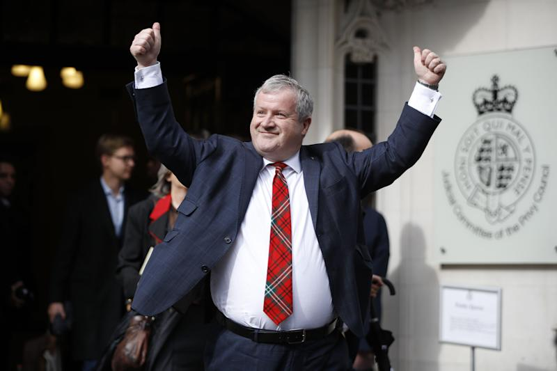 "Scottish National Party (SNP) Westminster leader Ian Blackford raises his arms as he comes out to speak to the media outside the Supreme court in central London on September 24, 2019 after the judgement of the court on the legality of Boris Johnson's advice to the Queen to suspend parliament for more than a month, as the clock ticks down to Britain's October 31 EU exit date. - Britain's Supreme Court on September 24 said that parliamentarians could reconvene ""as soon as possible"" after ruling that a decision by Prime Minister Boris Johnson to suspend parliament was unlawful. (Photo by Tolga AKMEN / AFP) (Photo credit should read TOLGA AKMEN/AFP/Getty Images)"
