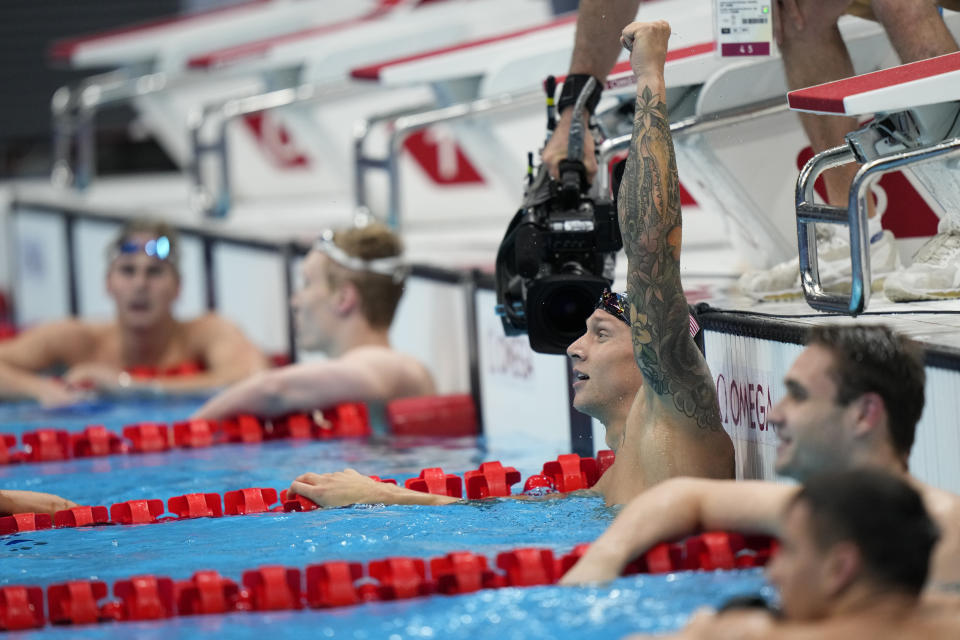 Caeleb Dressel, of United States, celebrates after winning the gold medal in the men's 100-meter butterfly final at the 2020 Summer Olympics, Saturday, July 31, 2021, in Tokyo, Japan. (AP Photo/David Goldman)